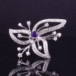 AMETHYST AND DIAMOND FLORAL BROOCH